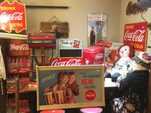 Coca Cola Vintage flanges etc coolers , door pushes, toys ,trays , bottles , cardboard signs Etc